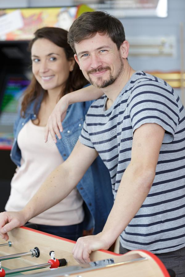 Couple playing table football at home stock photo
