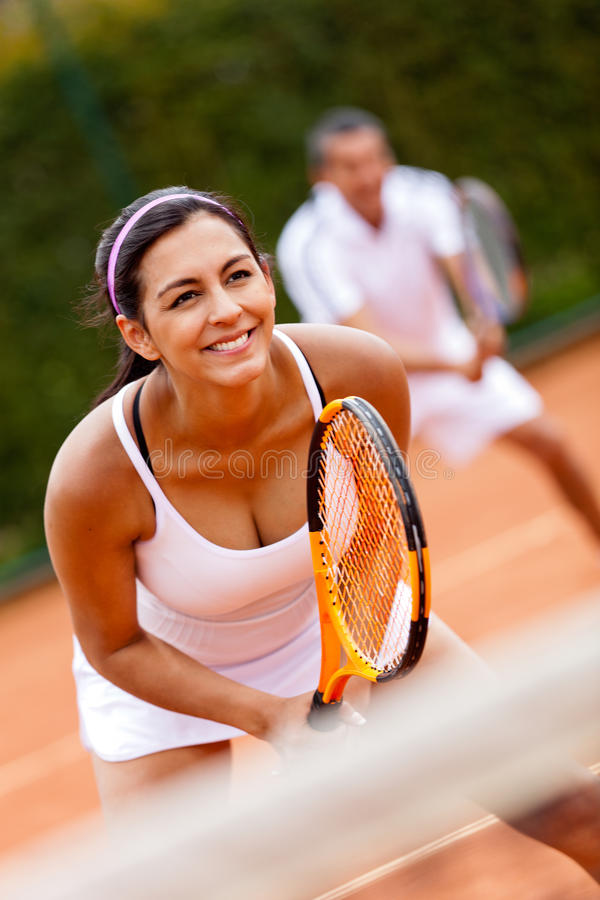 Download Couple playing tennis stock image. Image of court, game - 23033929