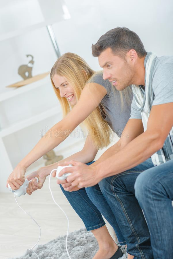 Couple playing video games. Accomplice stock image