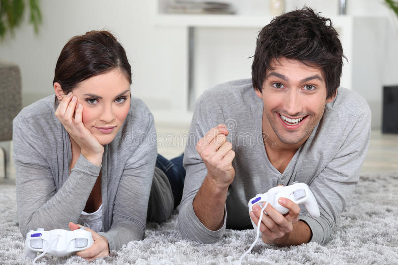 Couple playing video games stock image