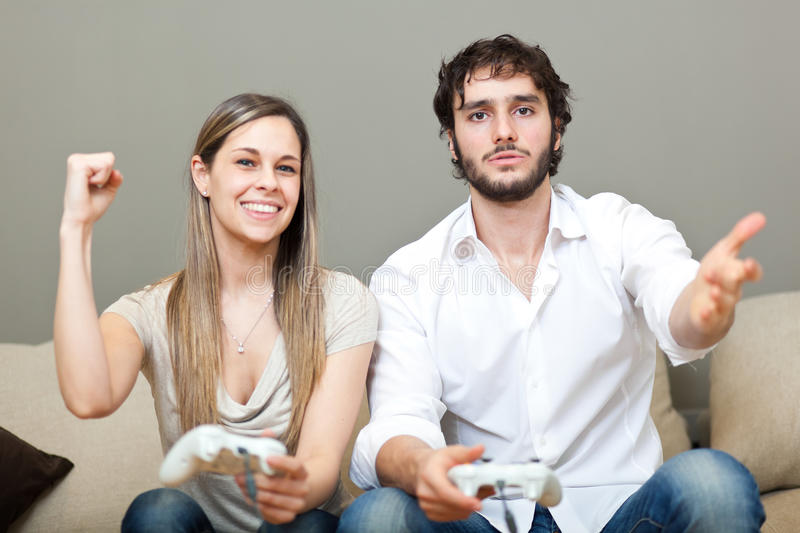 Playing video games stock images