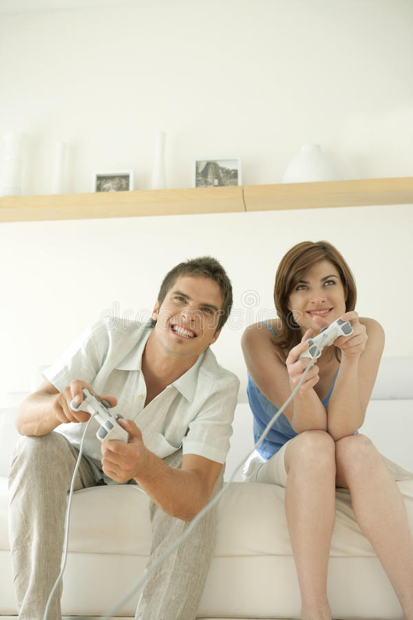 Download Couple Playing Video Games On Sofa Stock Photo - Image: 24787030
