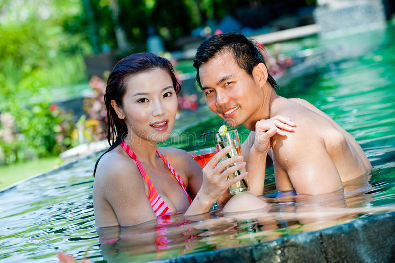 Couple In Pool stock photos