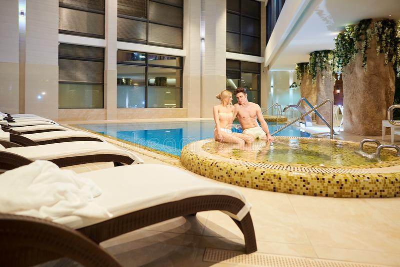 Couple in the pool resting spa center. stock photos