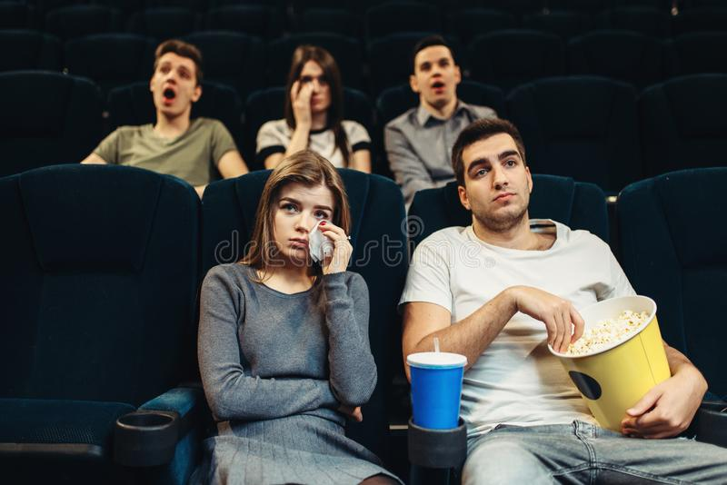 Boring film concept, people watching movie. Couple with popcorn in cinema. Boring film concept, people watching movie stock photo