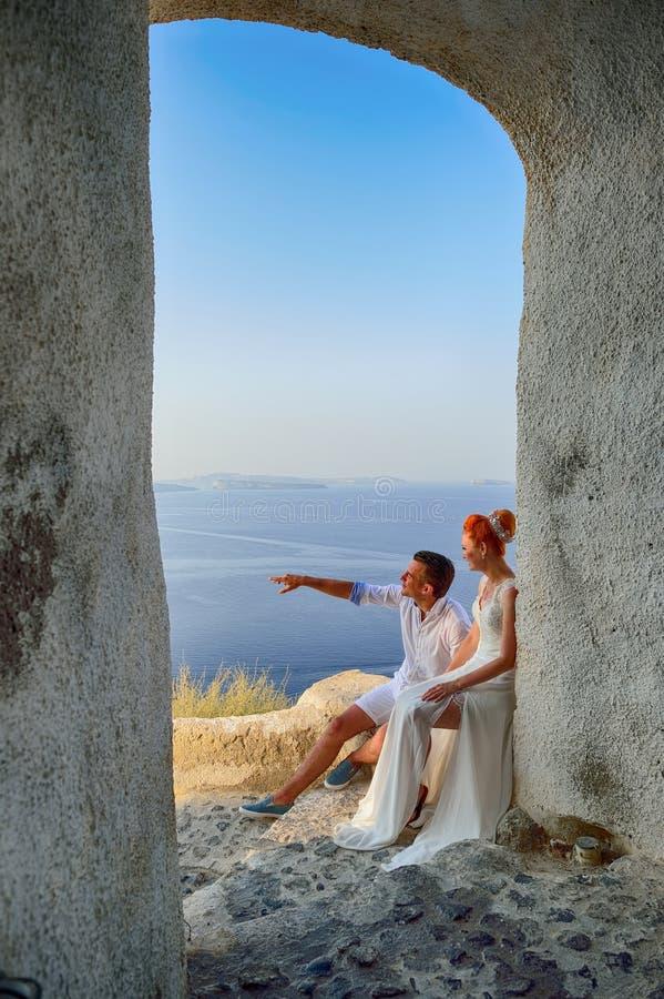Couple posing on Santorini island stock image