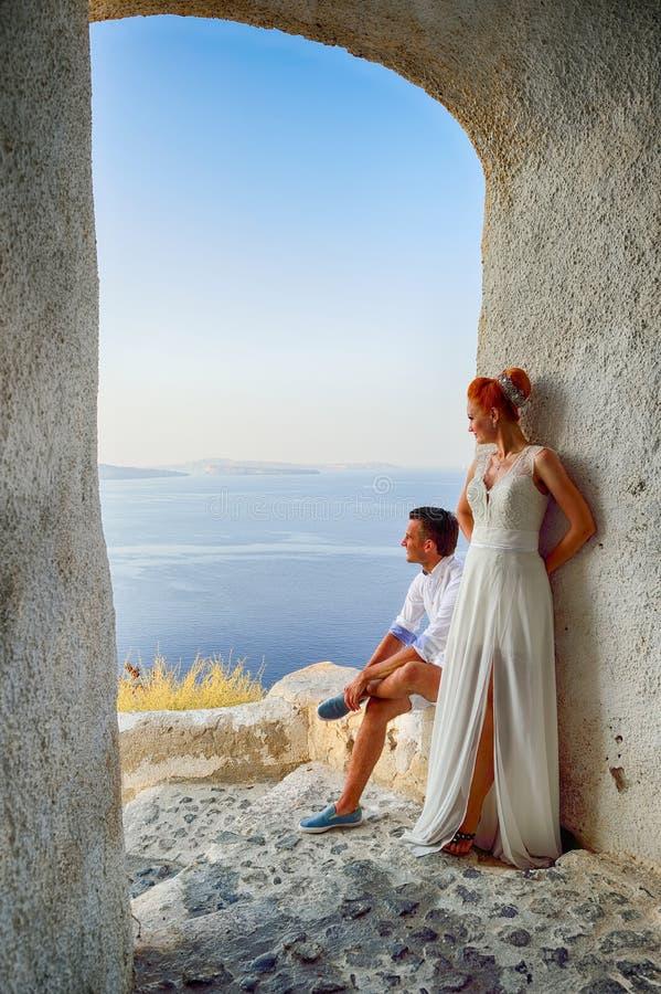 Couple posing on Santorini island. Beautiful young couple bride and groom posing on Santorini island, Greece royalty free stock photo