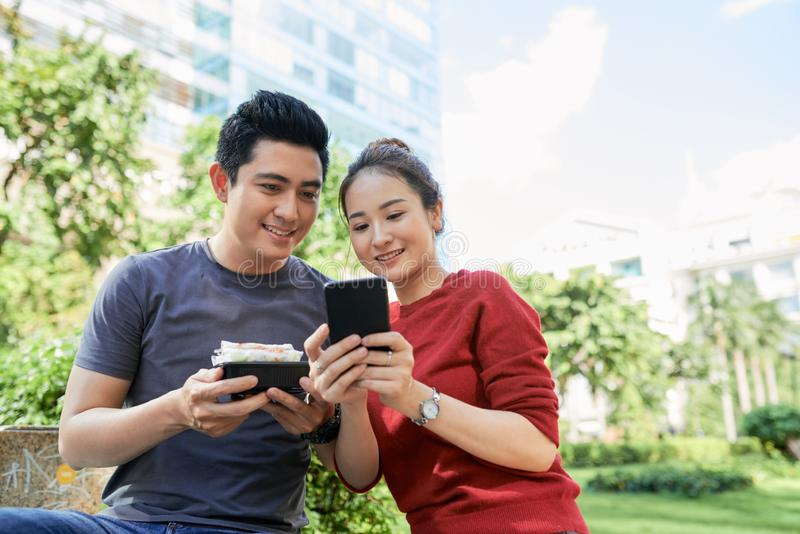 Couple posting photos royalty free stock photography