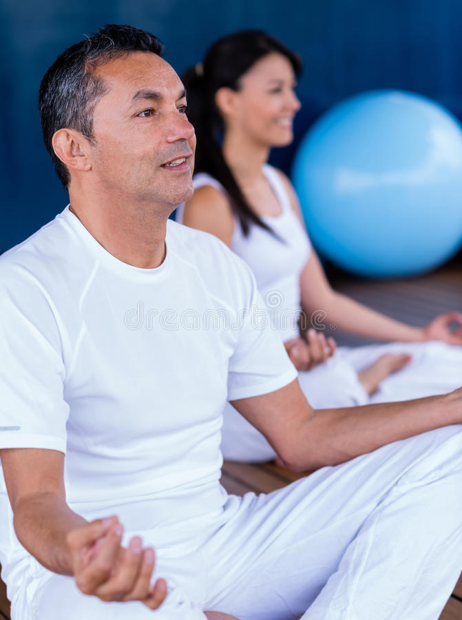 Download Couple practicing yoga stock image. Image of smiling - 31418081