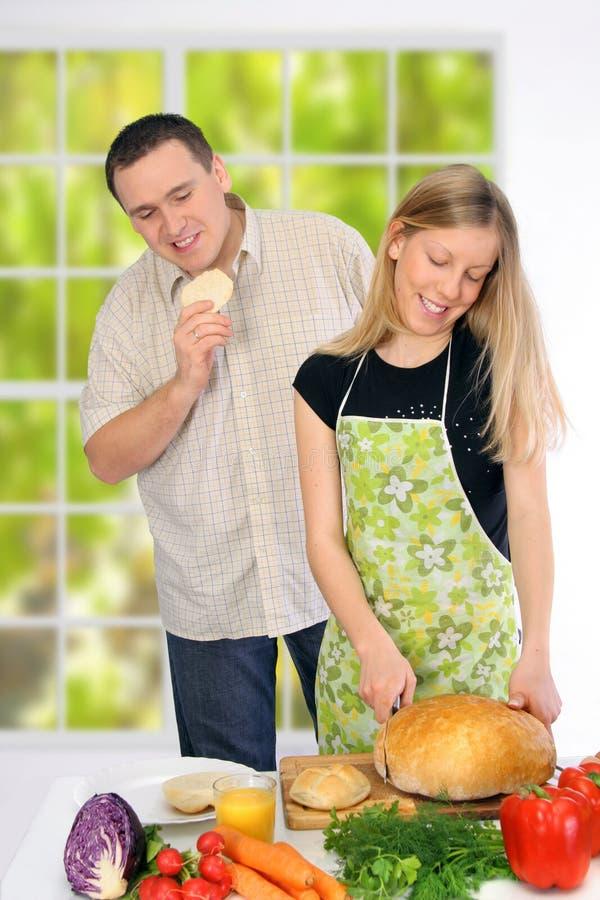 Couple Preparing Food stock images