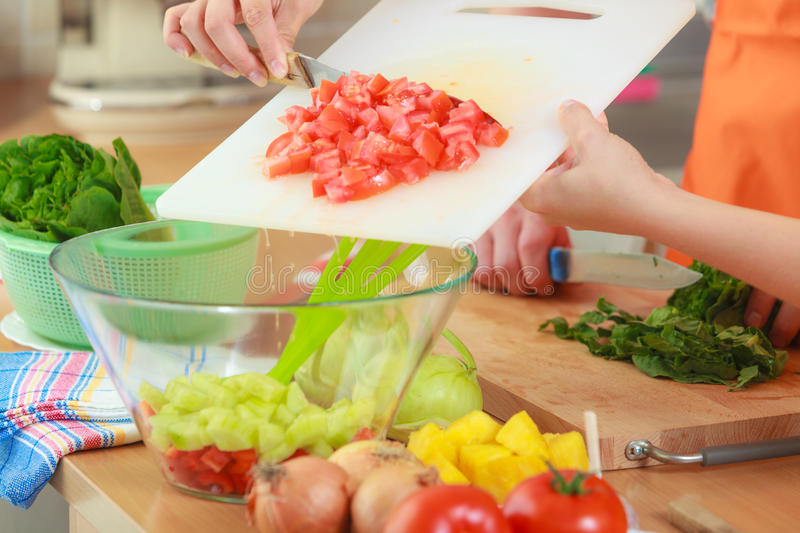Couple preparing fresh vegetables food salad. Healthy eating, vegetarian food, cooking, dieting and people concept. Couple in kitchen at home preparing fresh royalty free stock images