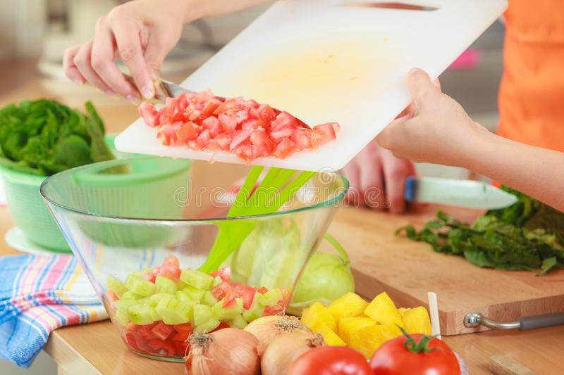 Couple preparing fresh vegetables food salad. Healthy eating, vegetarian food, cooking, dieting and people concept. Couple in kitchen at home preparing fresh stock photos