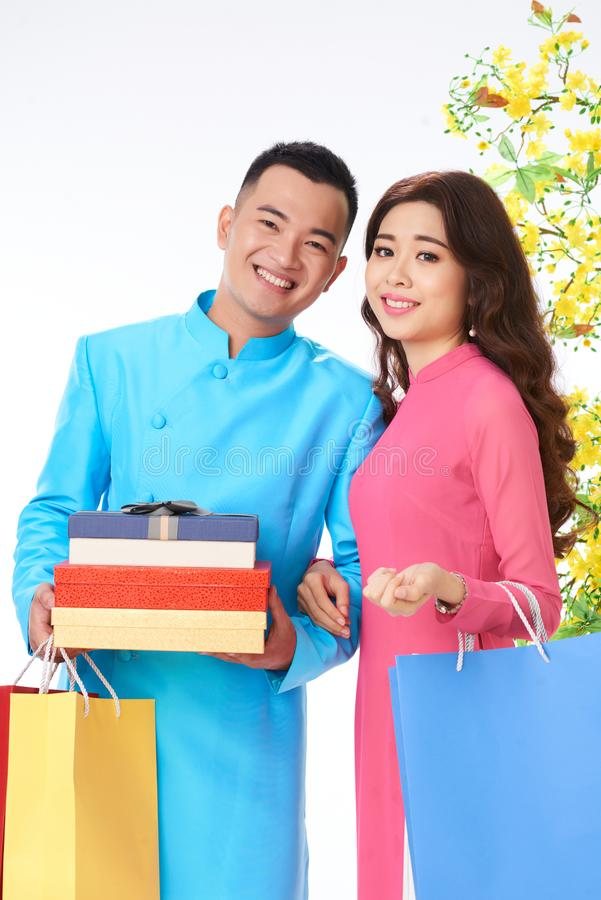 Couple with presents for Tet stock photos