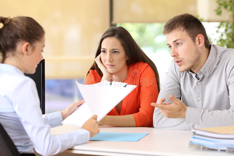 Couple with problems in a marriage counseling. Sad couple with problems talking in a marriage counseling stock images