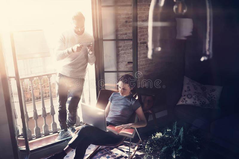 Couple professionals work together. Photo woman and bearded man working with new startup project in modern building. Couple professionals work together. Photo royalty free stock photos