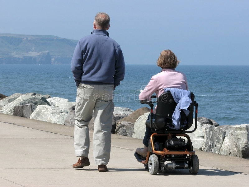 Couple on promenade stock photography