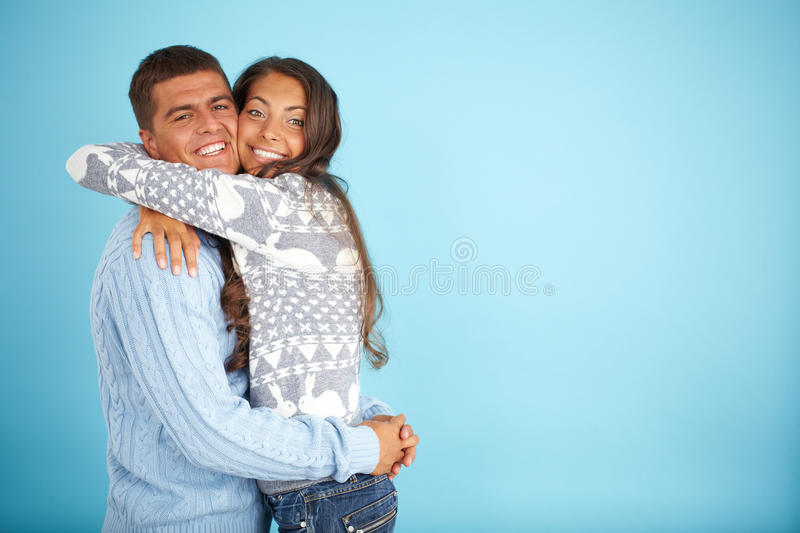 Couple in pullovers royalty free stock images