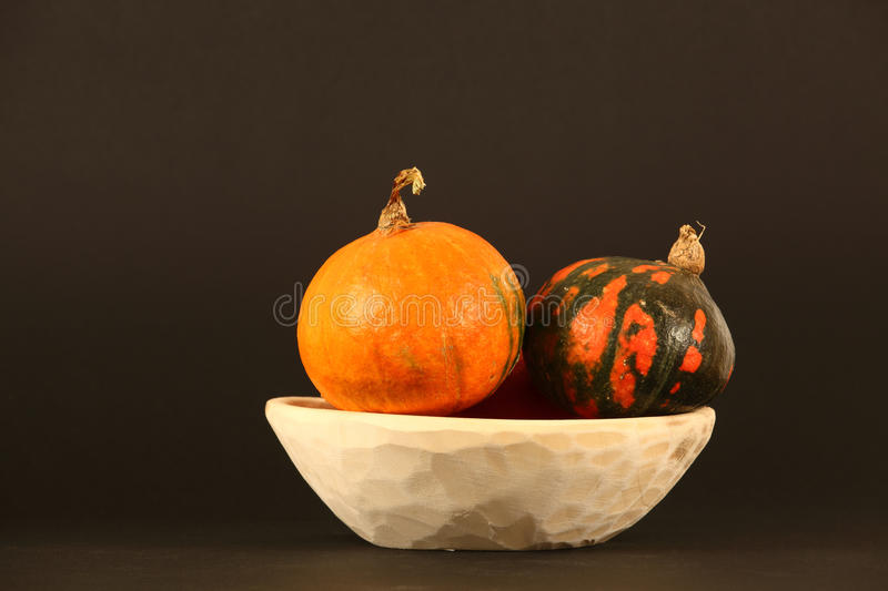 Couple of pumpkins on a plate stock photos