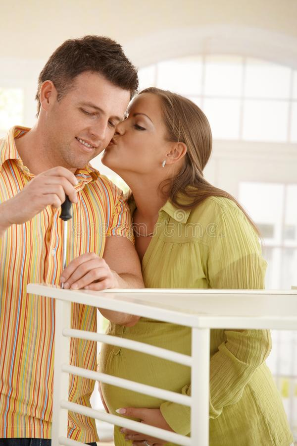 Couple Putting Up Baby Bed Stock Images