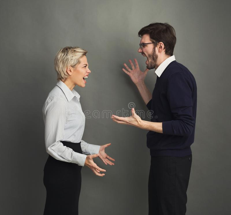Couple in quarrel, man and woman shouting royalty free stock photo