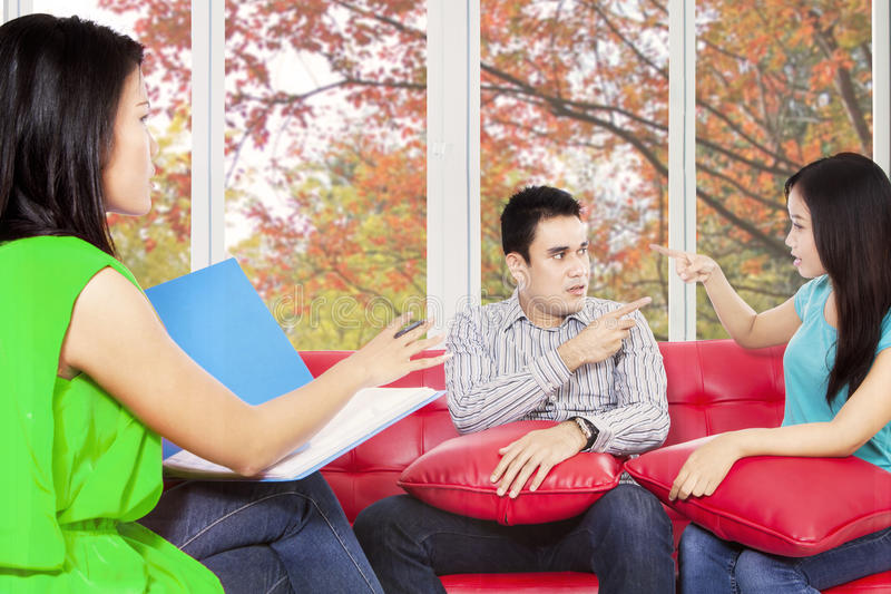 Couple quarreling when consult. Two hispanic couple quarreling when consult to psychiatrist royalty free stock images