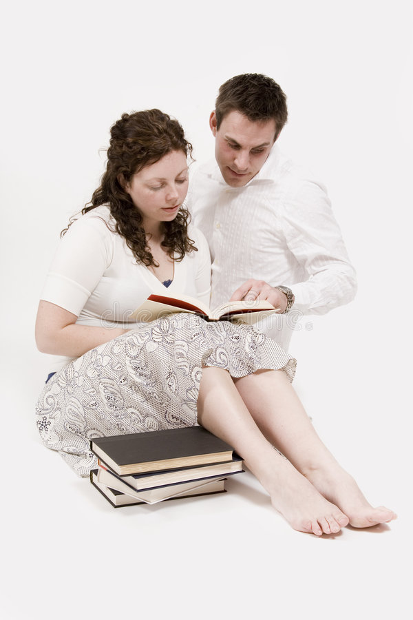 Couple reading royalty free stock photo