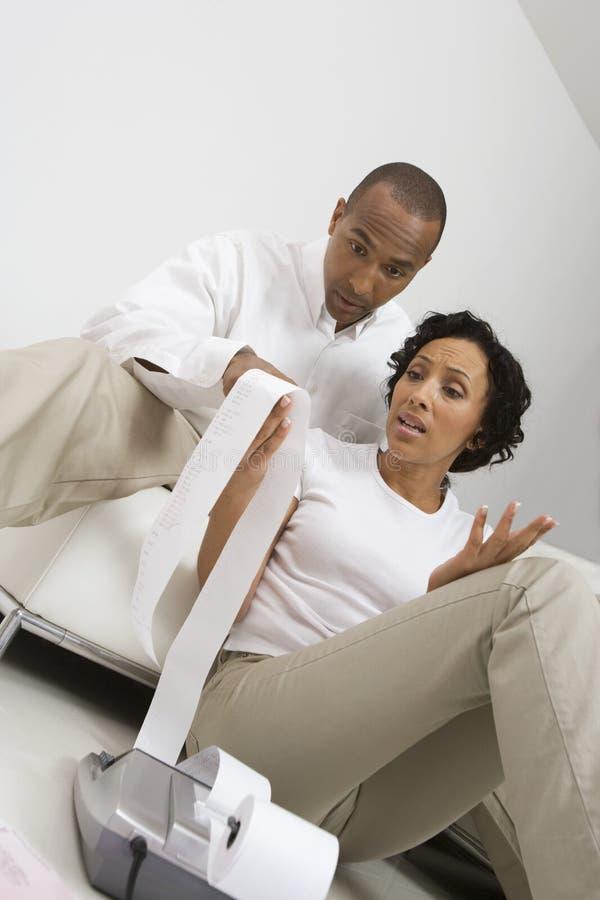 Couple Reading Adding Machine Tape