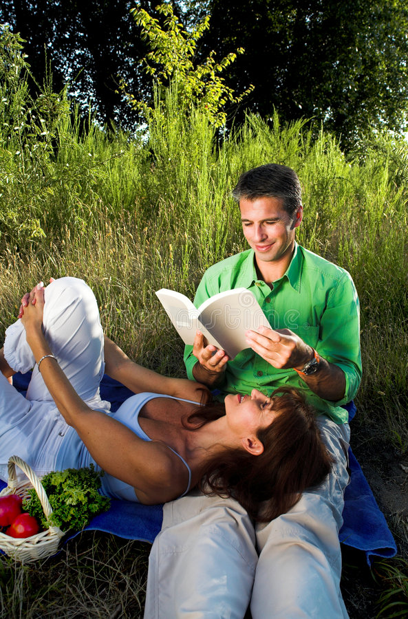 Download Couple reading a book stock photo. Image of smile, love - 2829496
