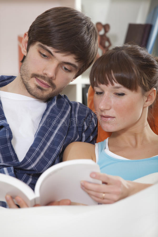 Download Couple reading book in bed stock photo. Image of looking - 17587610
