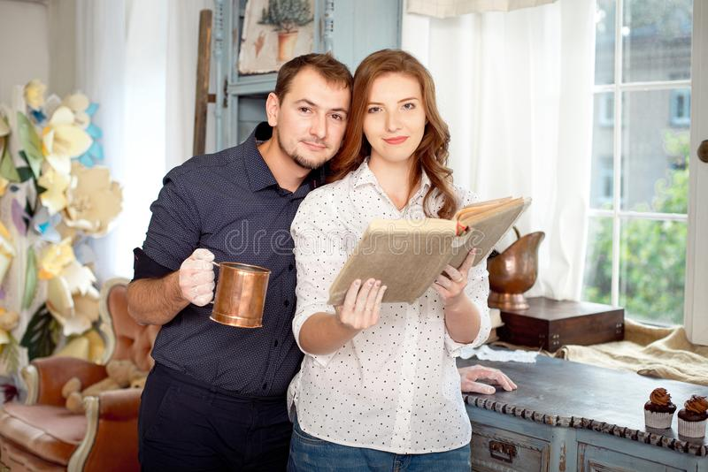 Couple reading a book of recipes to cook some dishes. stock photo