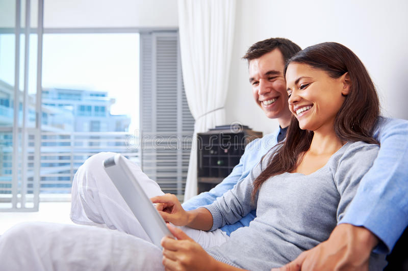 Couple reading at home stock image