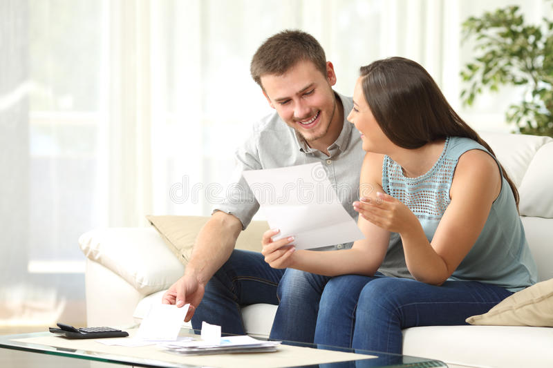 couple reading mail at home stock image