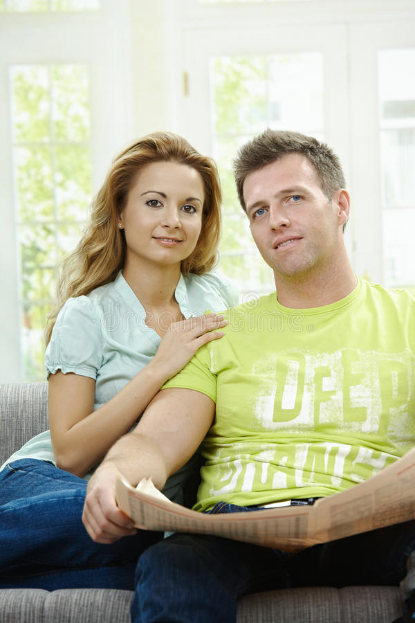 Download Couple reading newspaper stock image. Image of embrace - 12711219