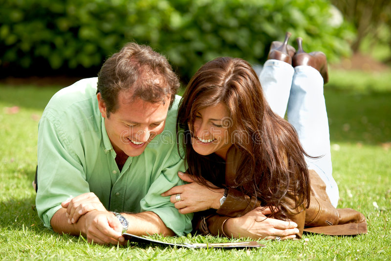 Download Couple reading outdoors stock image. Image of couple, back - 4624229
