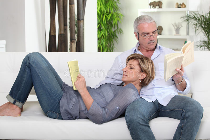 Couple reading stock images