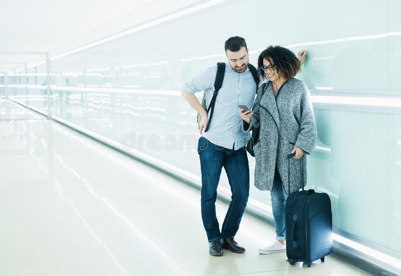 Couple ready to go on vacation using travel app stock photos