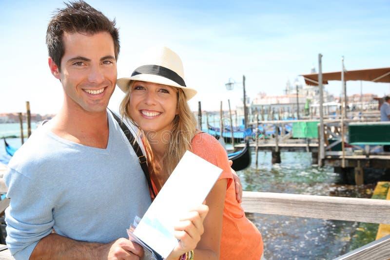 Couple ready to travel with gondola royalty free stock image