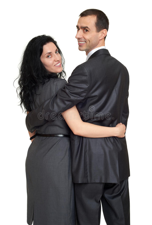 Couple rear view, people backside look around, dressed in classic suit, white background stock photo