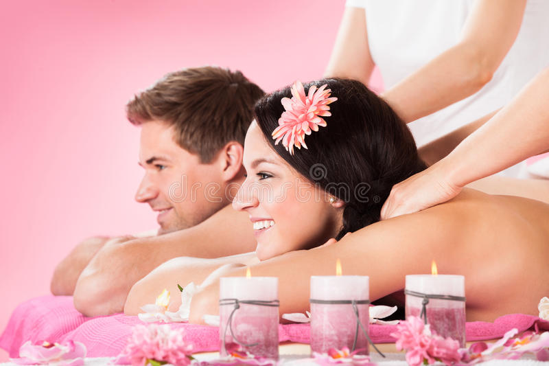 Couple Receiving Shoulder Massage At Spa royalty free stock images