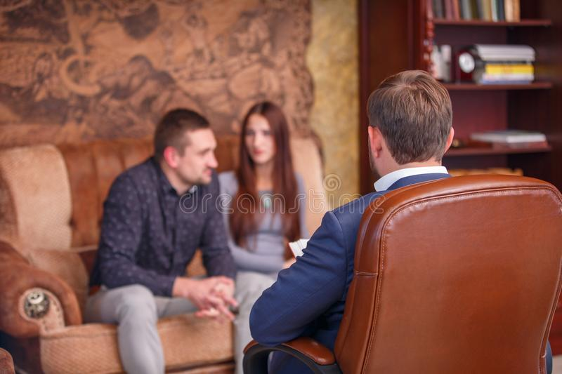 Couple at the reception of a psychologist royalty free stock images