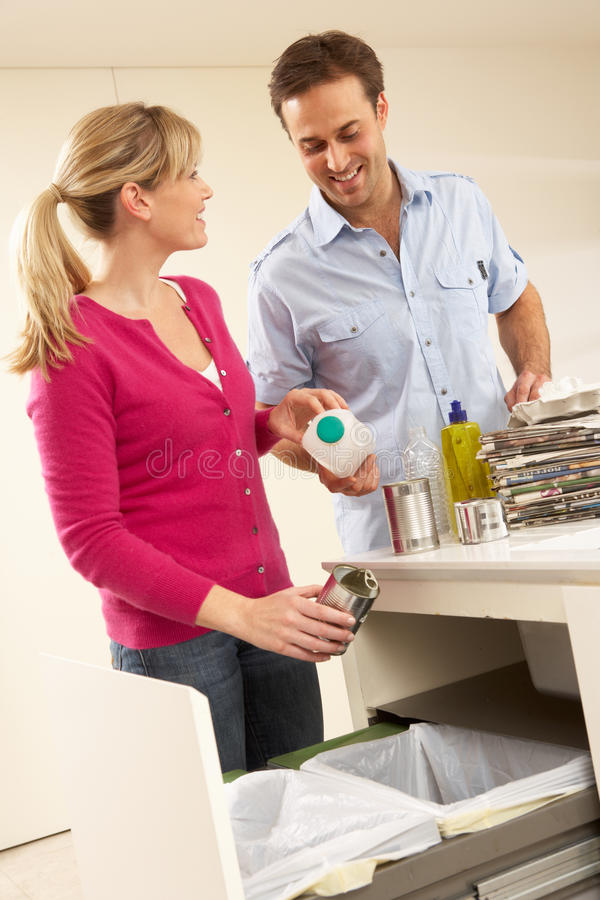 Couple Recyling Waste At Home stock images