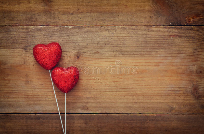 Download Couple Of Red Glitter Hearts On Wooden Background Stock Photo - Image: 83700969