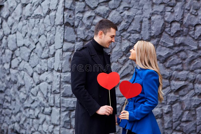 Couple with red heart in his hands on background. stock images