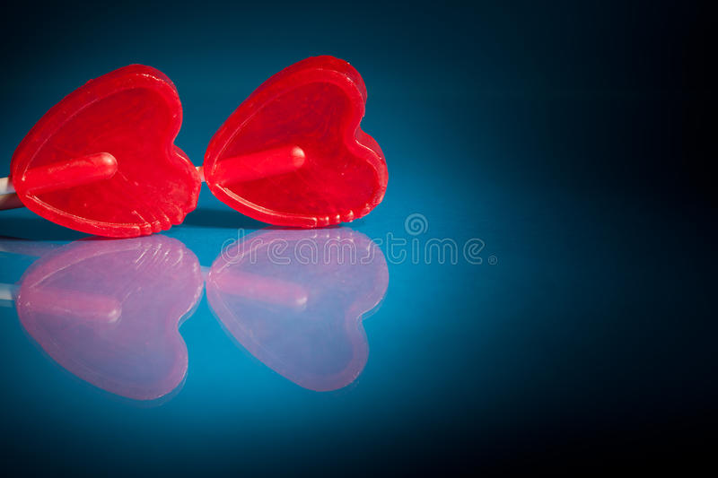 Couple Of Red Heart Lollipops Stock Image