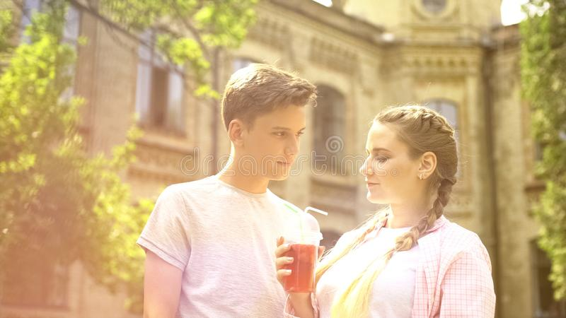 Couple with refreshing beverage standing in beautiful place, summer tourism royalty free stock photography