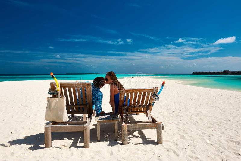 Couple relax on a beach at Maldives. Couple relax on a tropical beach at Maldives stock photo