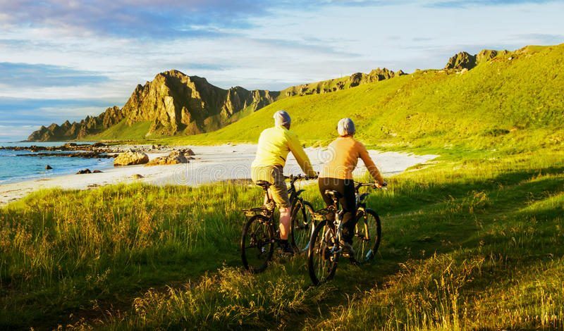 Couple relax cycling. In Norway stock photos