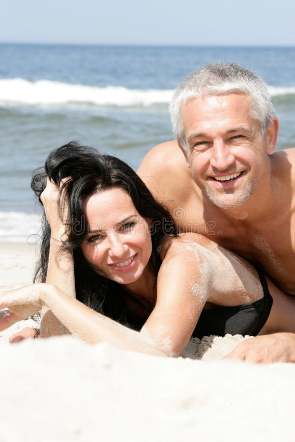 Couple Relaxing On The Beach Stock Photos