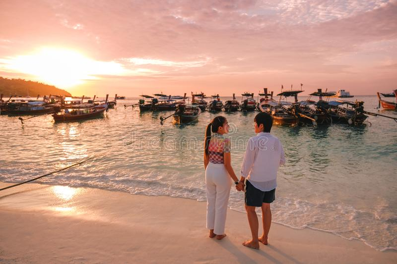 Couple relaxing beautiful sunset on Koh Lipe Beach Thailand ,Summer vacation stock photos