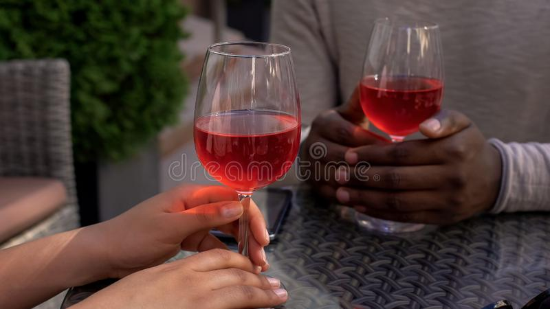 Couple relaxing in cafe with wine glasses on table, romantic date, relationship royalty free stock photo